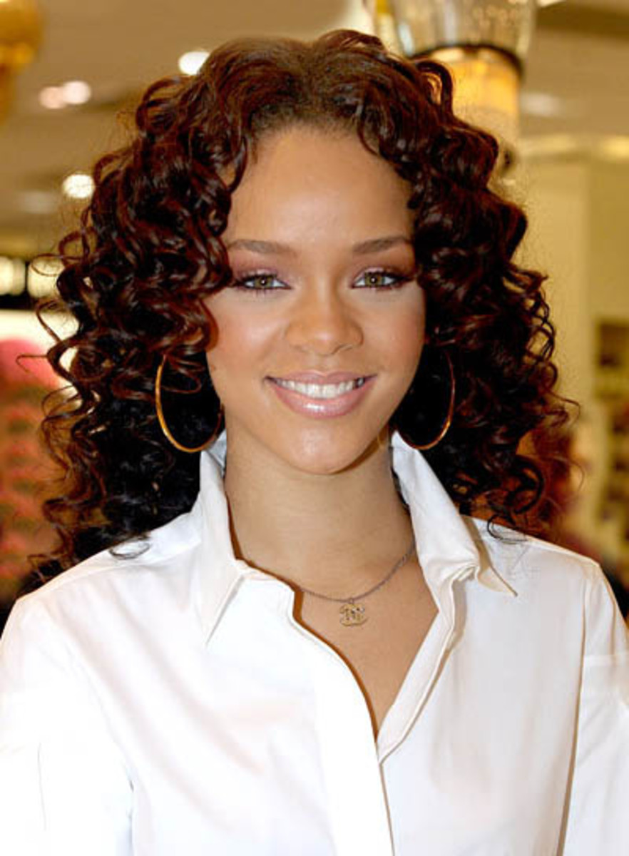 rihanna always shows some different style with her short curly hairstyles