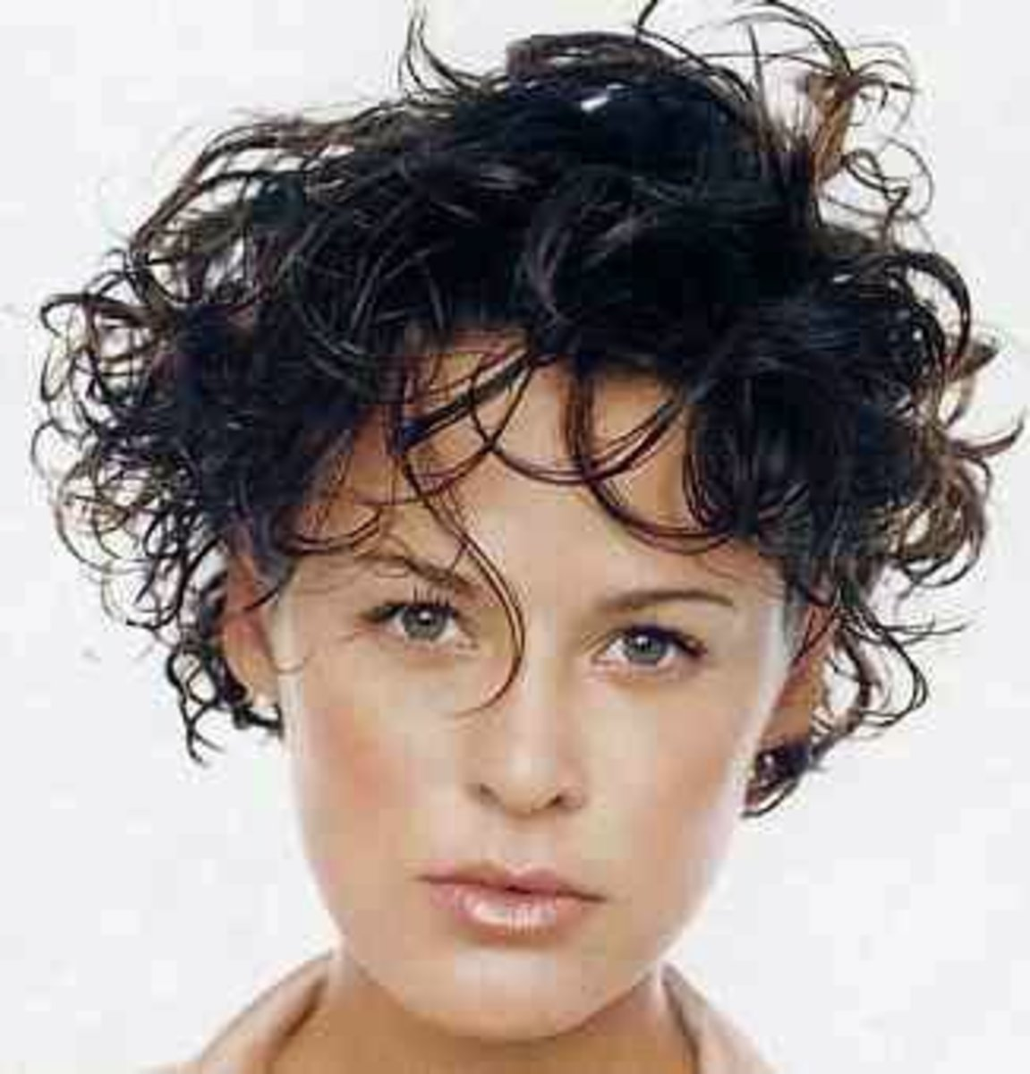 short boyish look hair cut with some beautiful curls