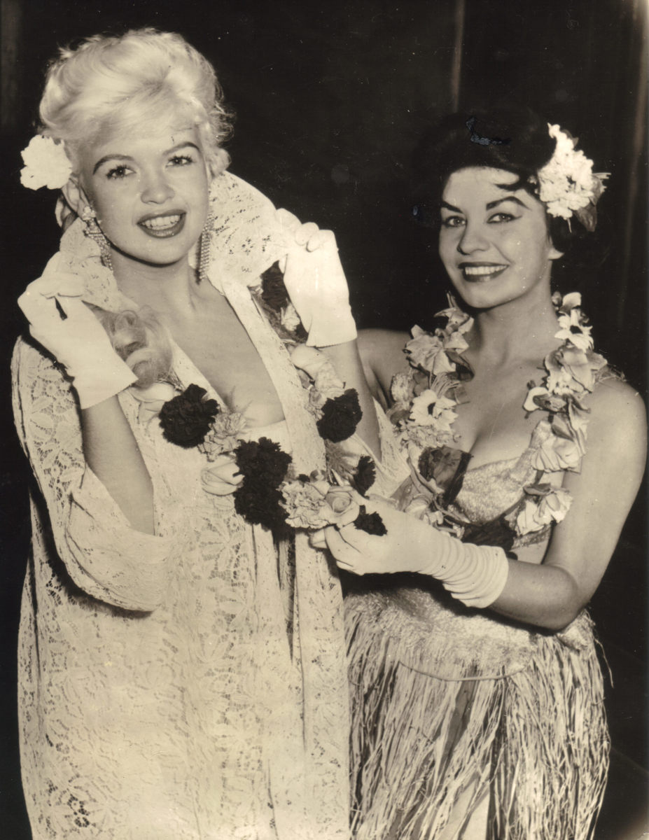 Mary Presents Jayne Mansfield with a Flower Lay