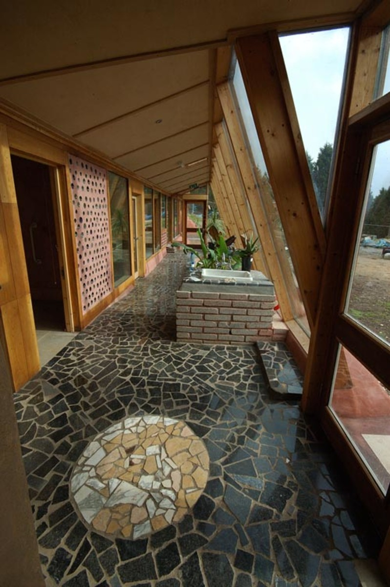 Attention to detail is seen with intricate stone work in the entry to this gorgeous Earthship.