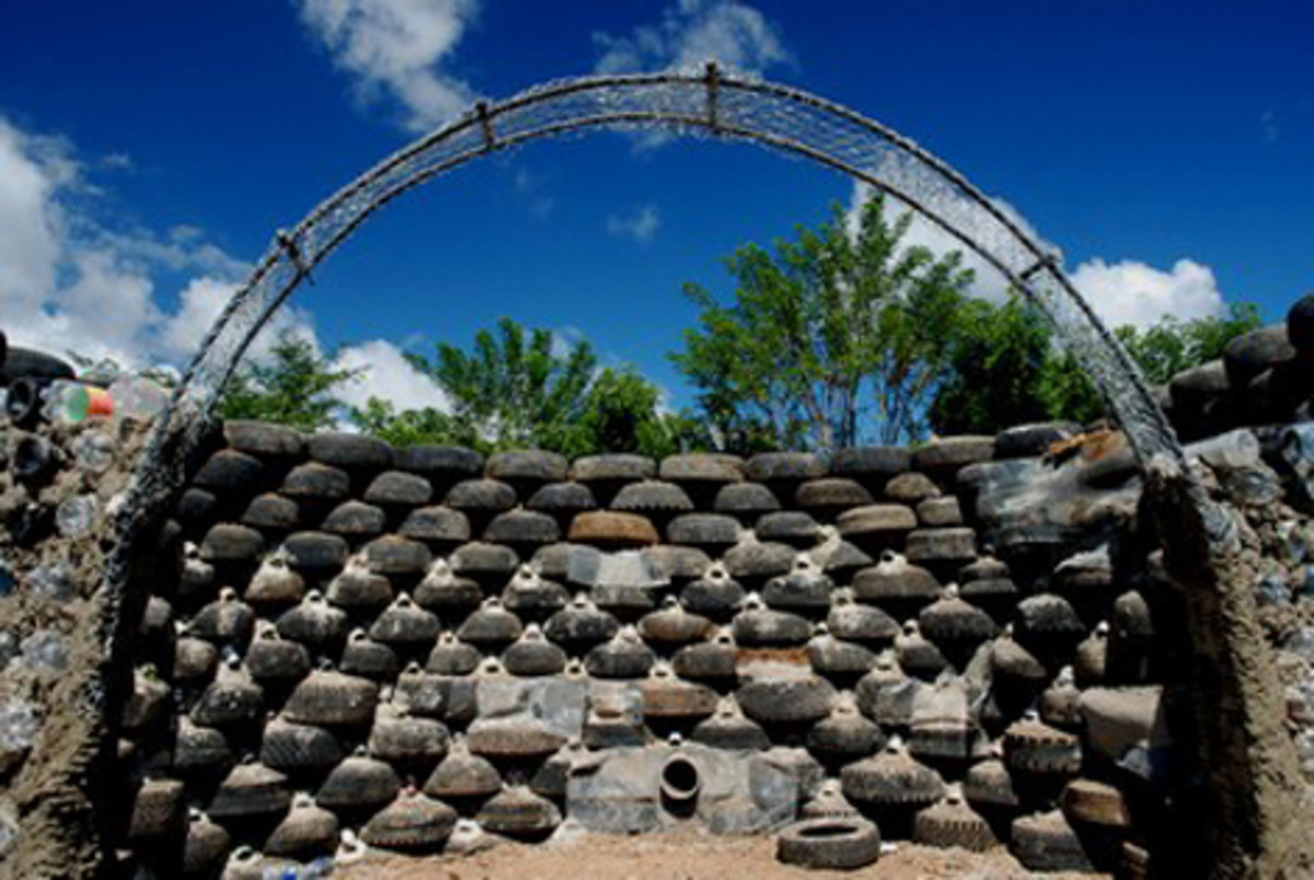Tires are packed with dirt and stacked like bricks to form the infrastructure of the Earthship home.