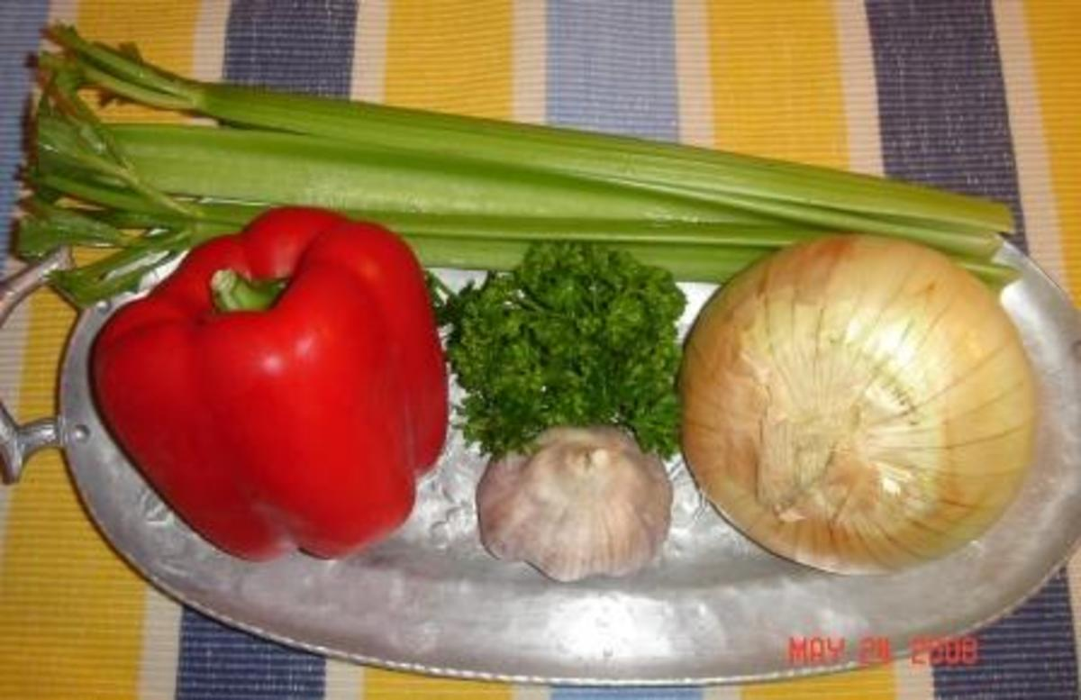 The Cajun Trinity consists of onion, bell pepper, and celery.  Garlic and parsley can be added.