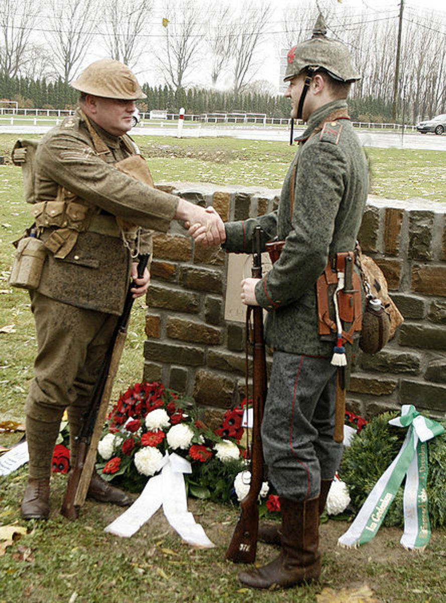 Peter Knight and Stefan Langheinrich, descendants of Great War veterans, shake hands at the 2008 unveiling of a memorial to the 1914 Christmas Truce.