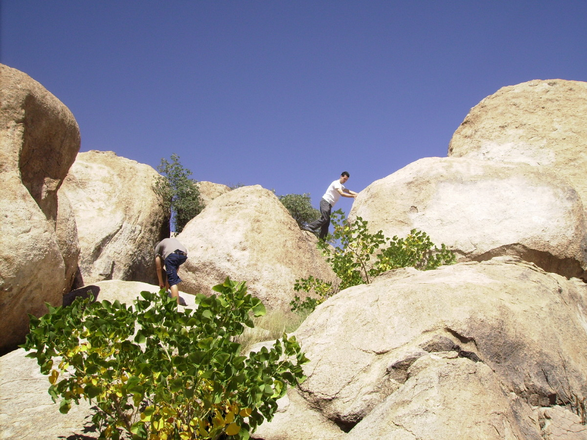 Climbing the boulders found in Texas Canyon Rest Stop along Interstate 10 in southern, Arizona.