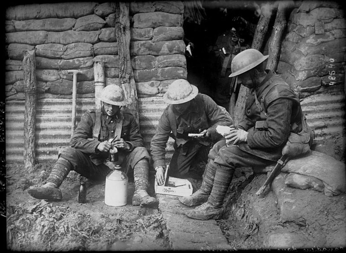 Canadian soldiers manage to get a break and relax for a while in the trenches.
