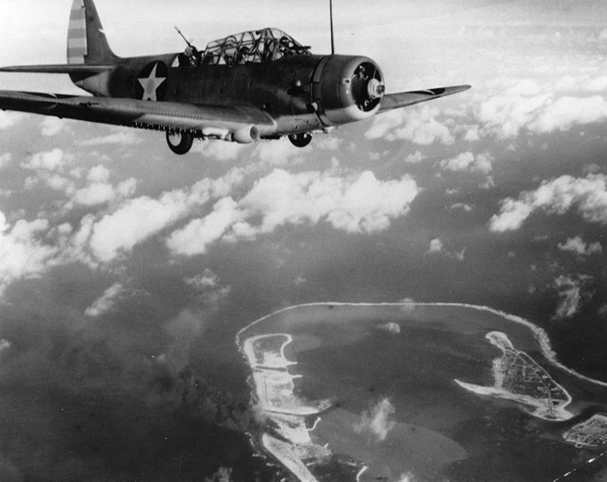A Douglas TBD-1 Torpedo plane from the aircraft carrier USS Enterprise over Wake Island