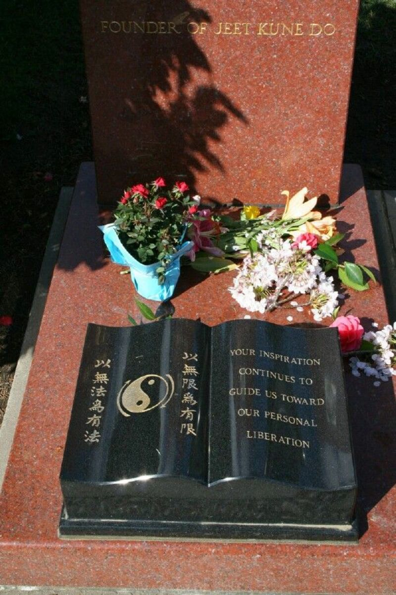 Bruce Lee Grave. Many people have reported seeing him setting on the bench in front of his grave. He is also seen other places.