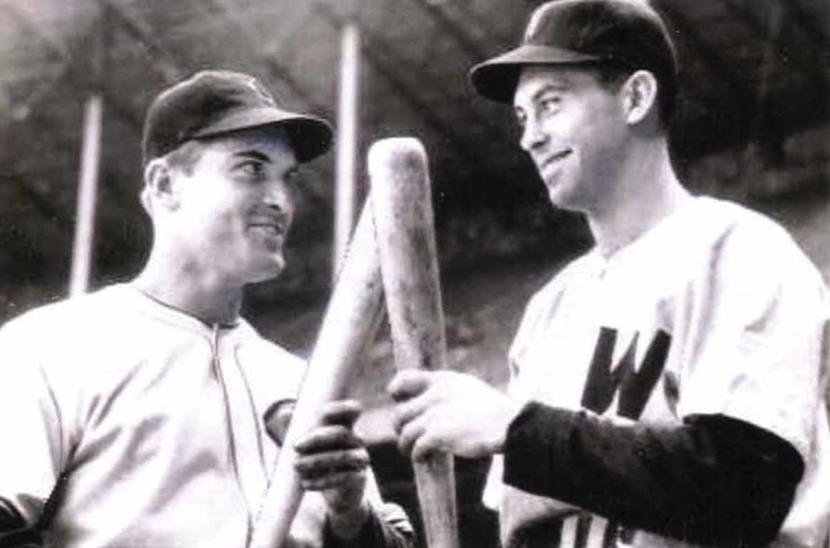 Jeff Heath of the Cleveland Indians (left) poses with Cecil Travis before a game on May 5, 1941. His ghost is often seen still watching the game