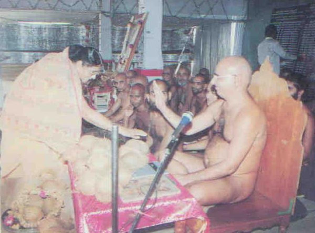nude saint blessing devotees at a function