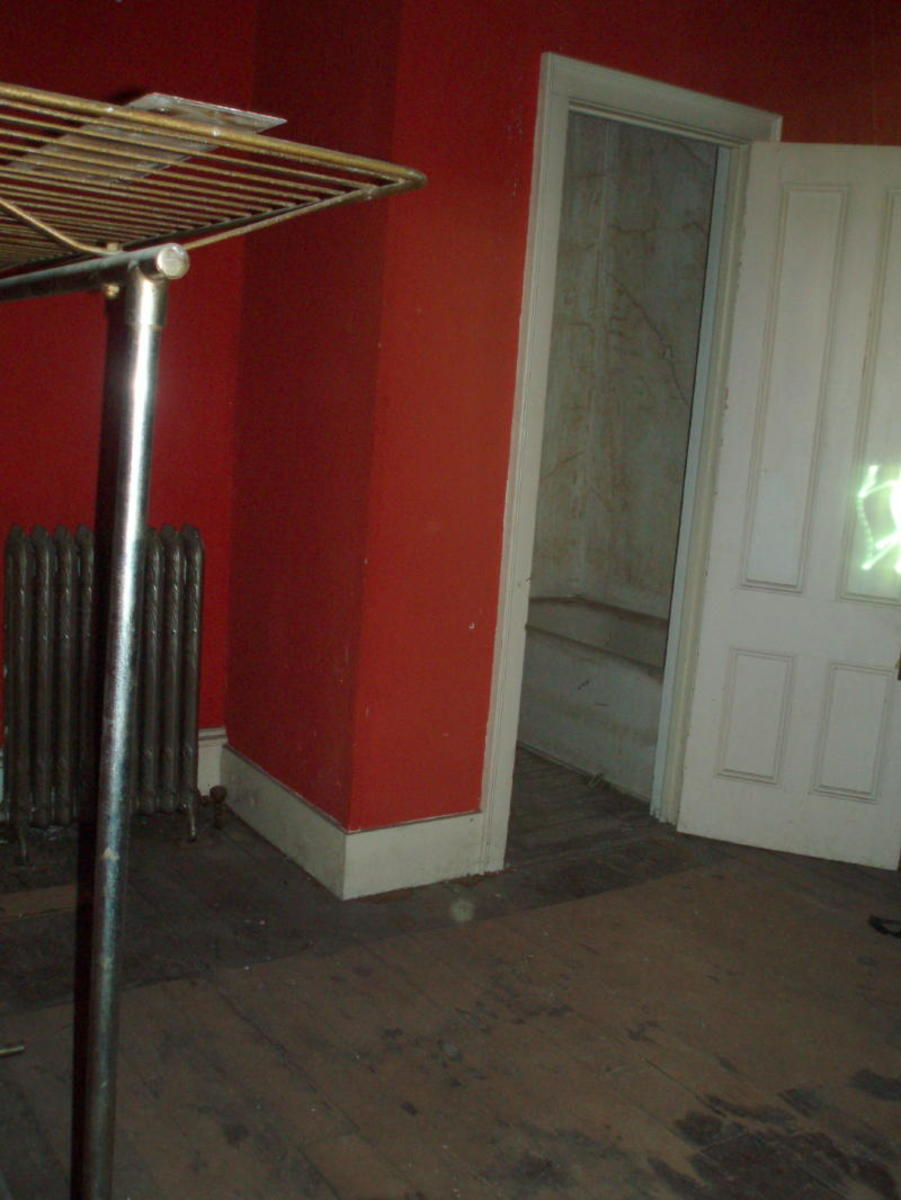 Paranormal activity (right of photo) at the doorway to the infamous red room's haunted bathroom