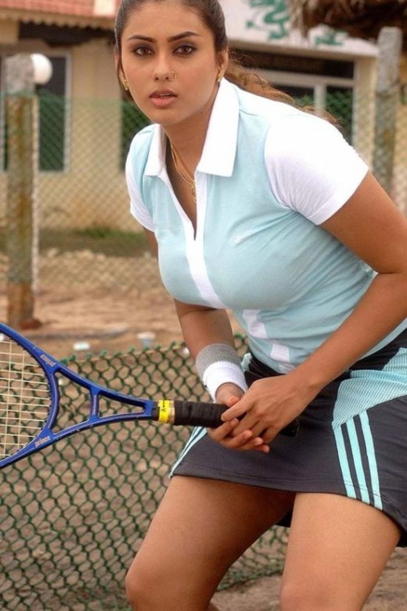 Namitha, doing a Sania Mirza act, Playing Tennis