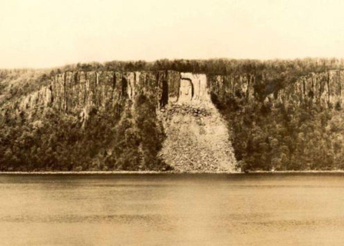 "The ""Hitler"" face, c. 1941 on the Palisades of New Jersey as seen from the Hudson River. See upper left side of the rockslide. Another rockslide obliterated the face after WW II. (Photo by the Yonkers Ferry Corporation)."