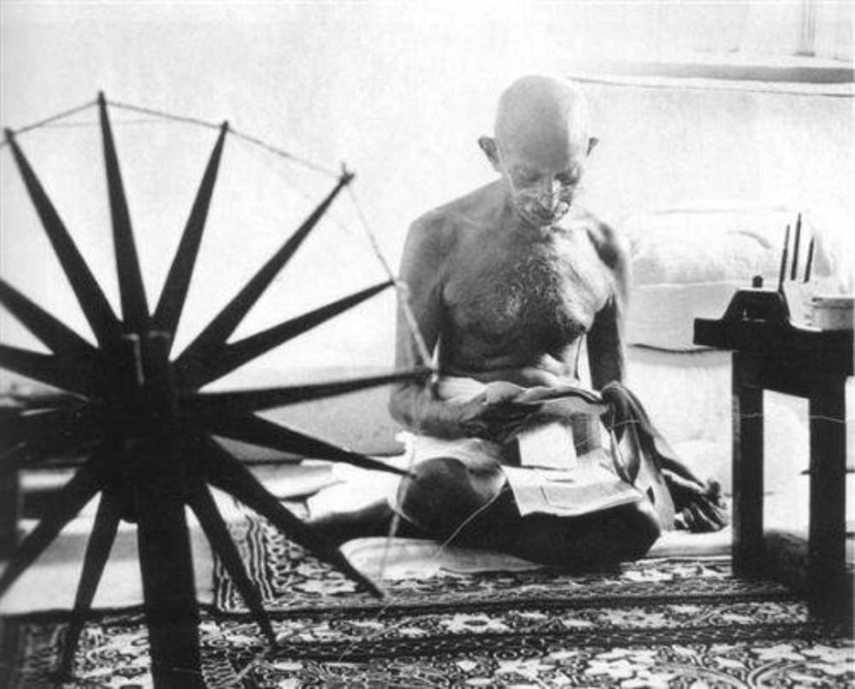 Gandhi with his spinning wheel, one of the symbols of freedom struggle in India.