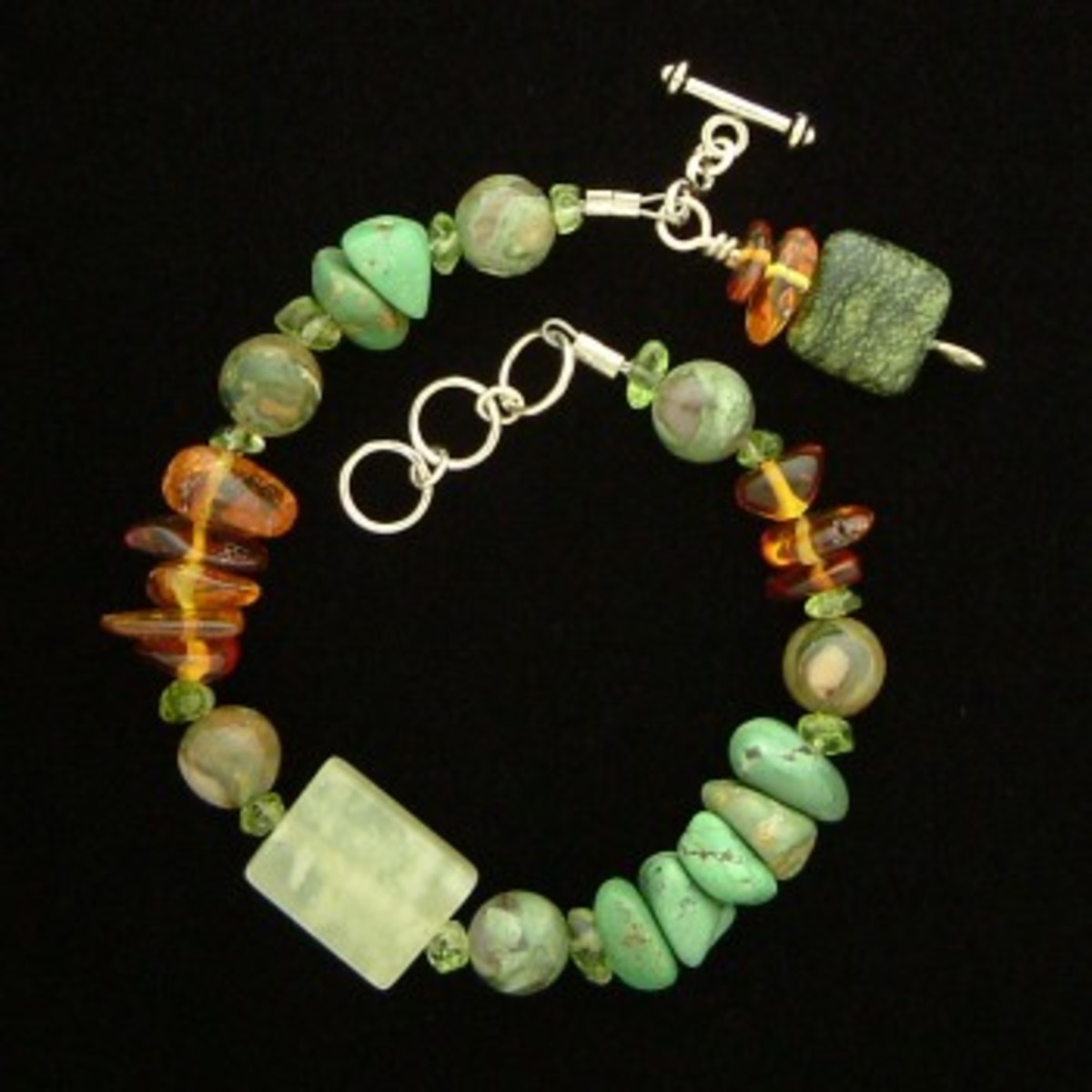 Green turquoise, amber, and other gems
