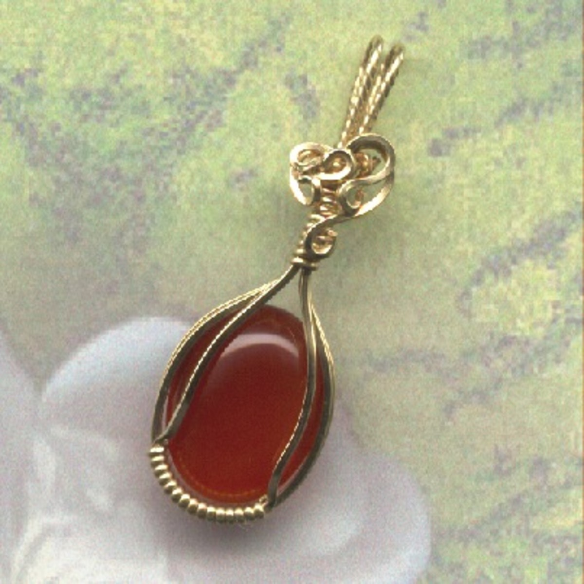 Paper background placed over the back of this carnelian pendant looks almost like a real flower.