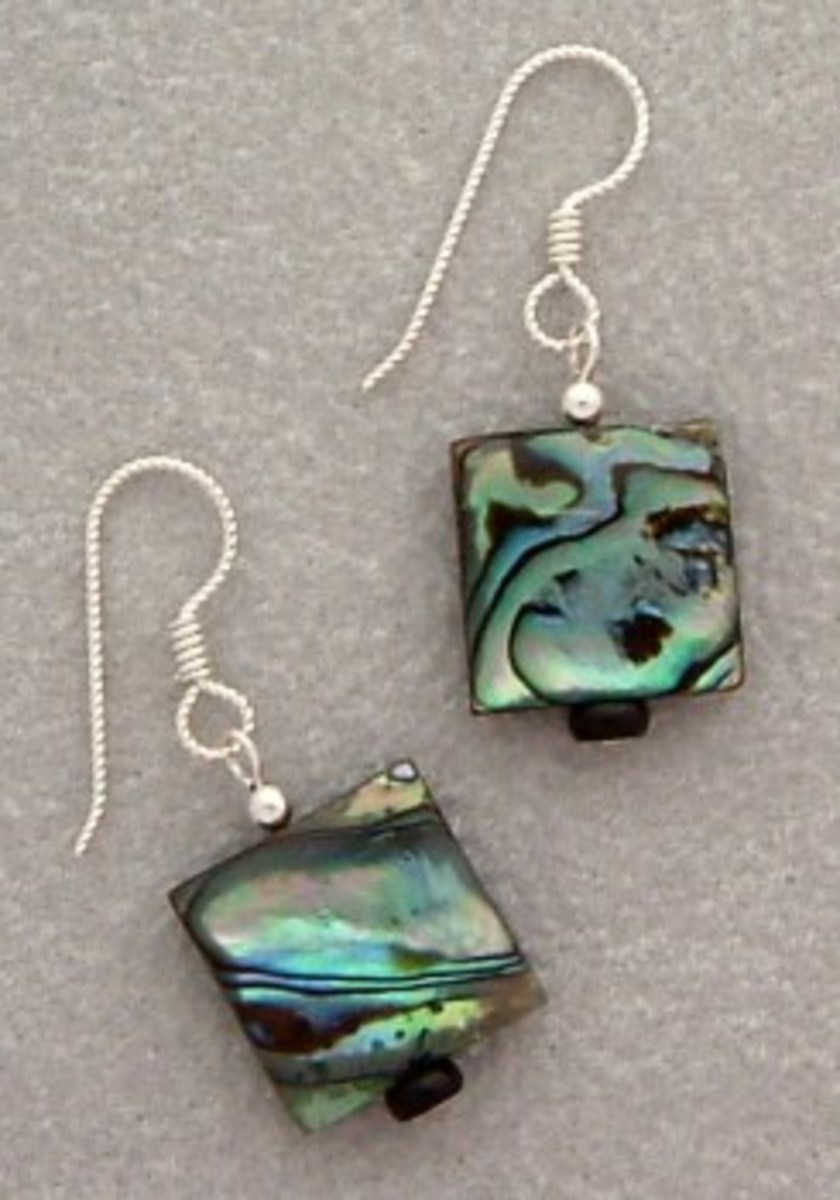 Paua shell and sterling silver with gray ultrasuede background.