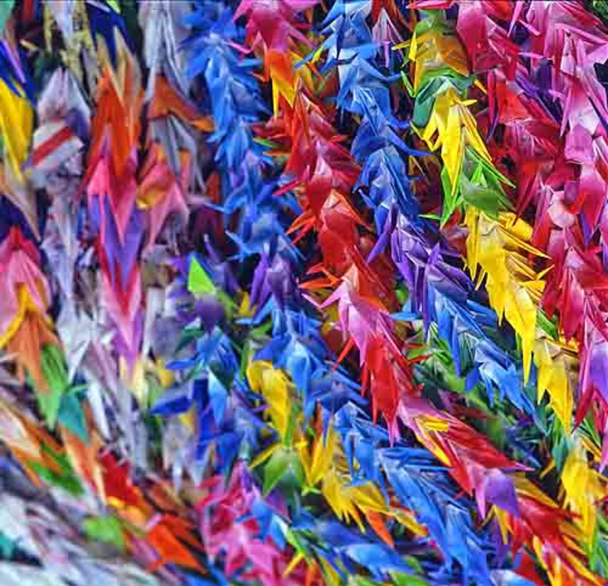 Strings of paper cranes for prayers of peace sent to Peace Memorial Park in Hiroshima. (public domain)