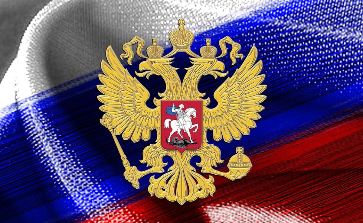 Flag of Russia with the coat of arms of the Old Russian empire in the middle.