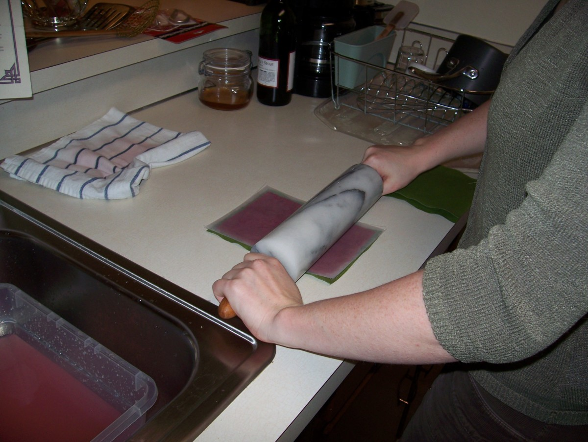 Step 8: Couch the pulp by rolling the blotter, pulp, screen sandwich.