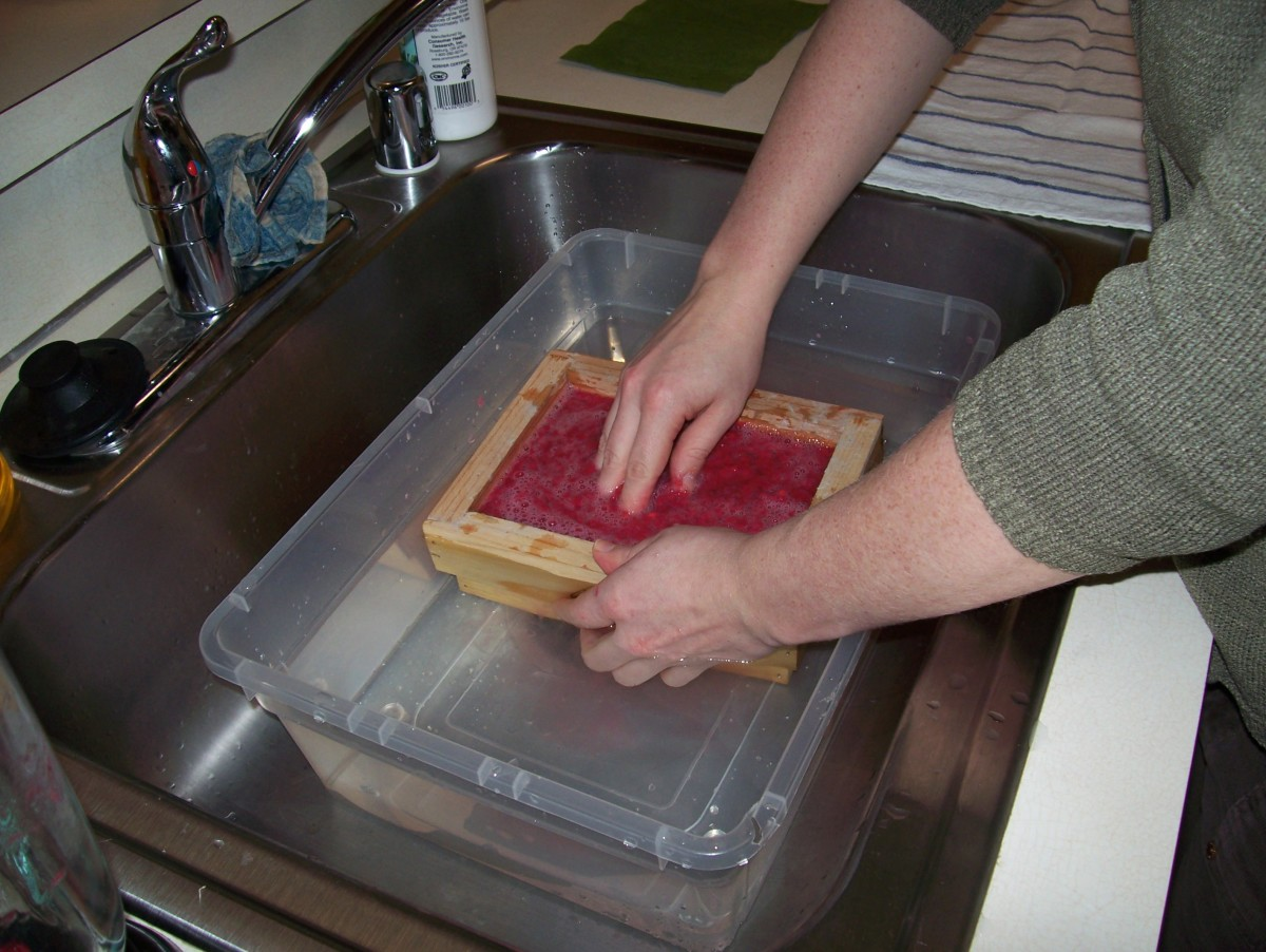 Step 4: Swish the deckle around.  You can also swish the pulp with your fingers.