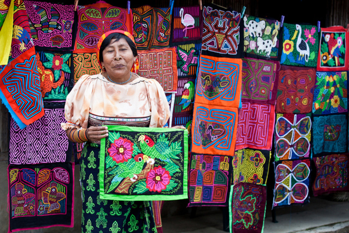 A Kuna indigenous woman with her artworks.