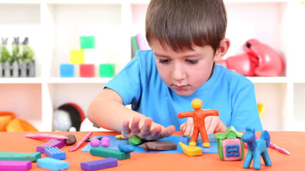 Child enjoying play dough.