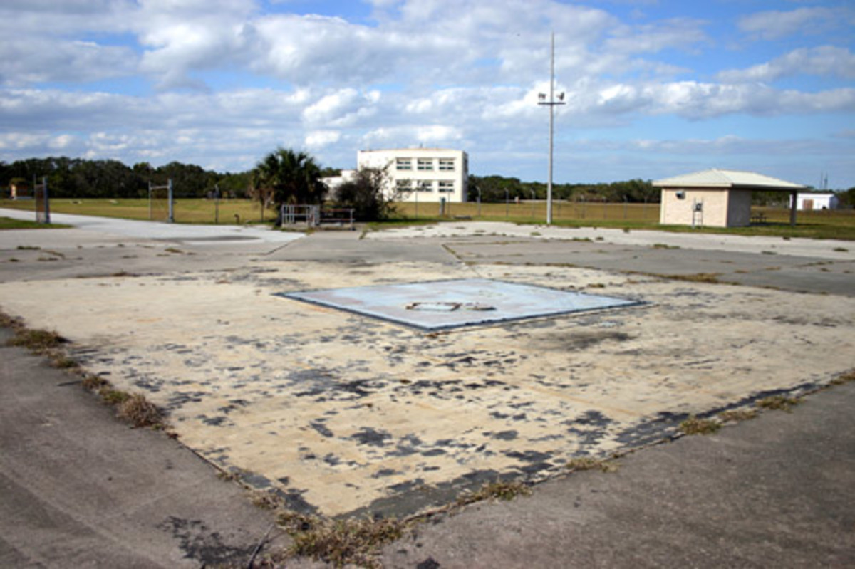 Discarded Dreams of Camelot: Cape Canaveral, Pad B - Represents the loss of key people and an important Era, including the US Space Program, which was John F. Kennedy's dream.