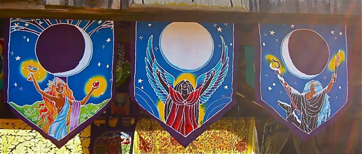 A trio of prayer flags shows how the Maiden, Mother and Crone align with the phases of the moon cycle.