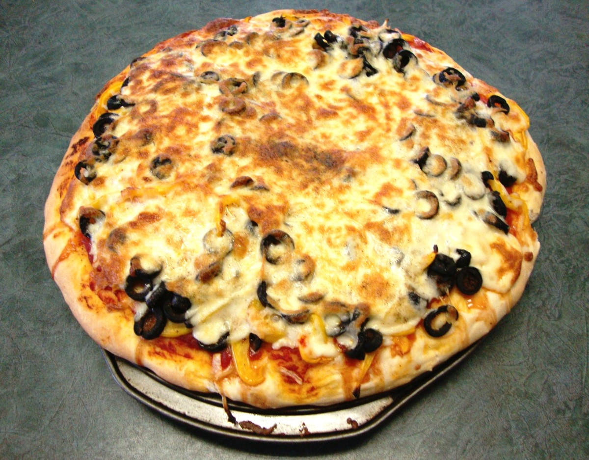 A thick, tender pizza smothered in Mozza, onions, red and yellow peppers and black olives.