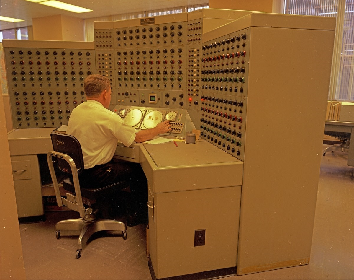 Seattle City Light staff at the analog Enns Power Network Computer, 1968. Glorified typewriter?