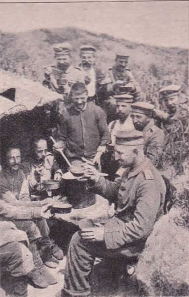 German soldiers trying to eat while fighting. Meals were often the high points of the day.