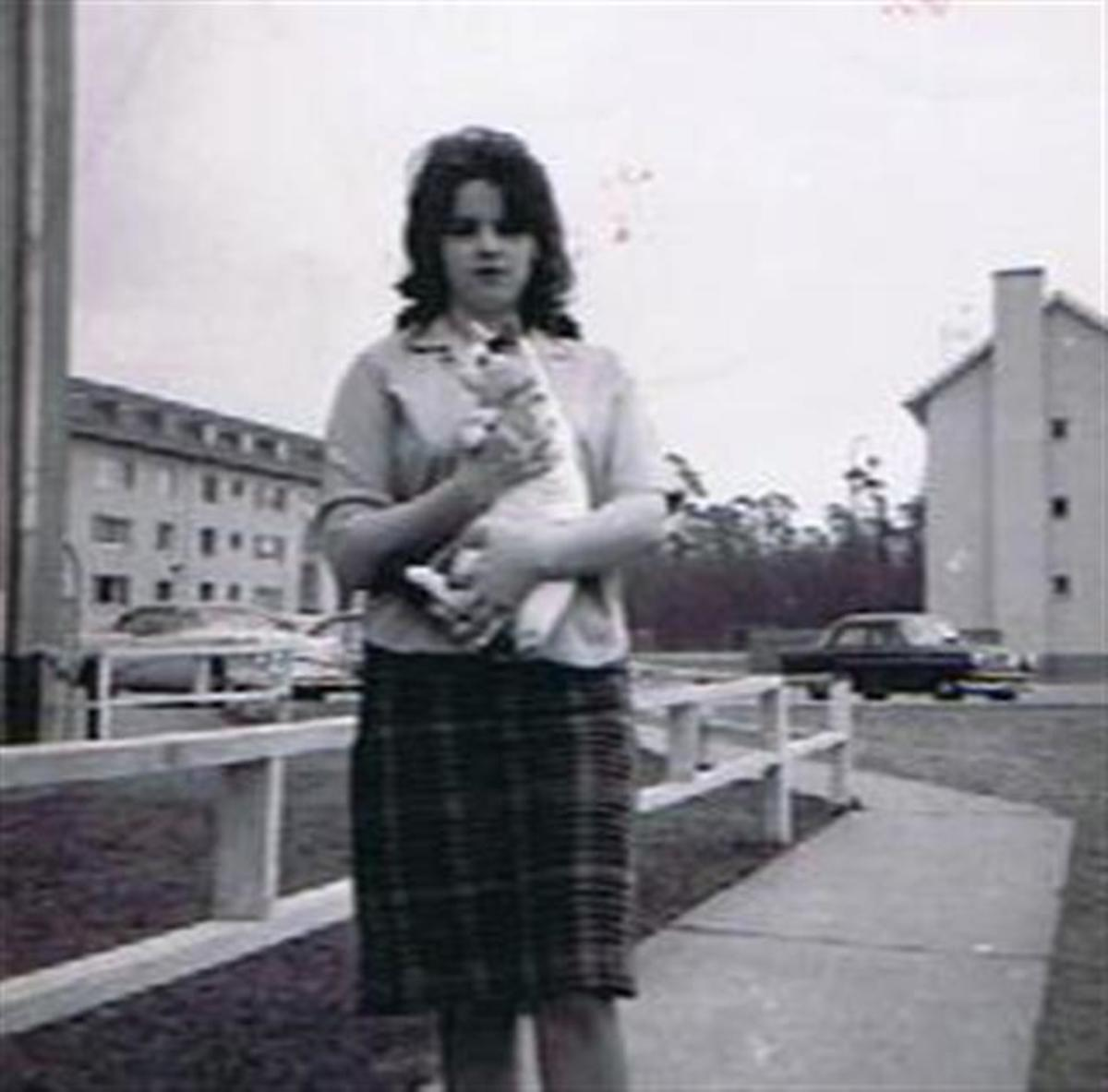 Kathy Schoen with our cat.