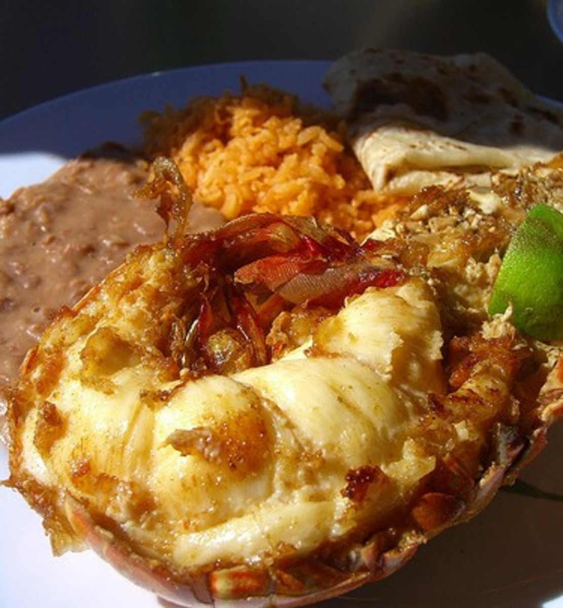 Puerto Nuevo Lobster served with rice, beans, tortilla and lime.