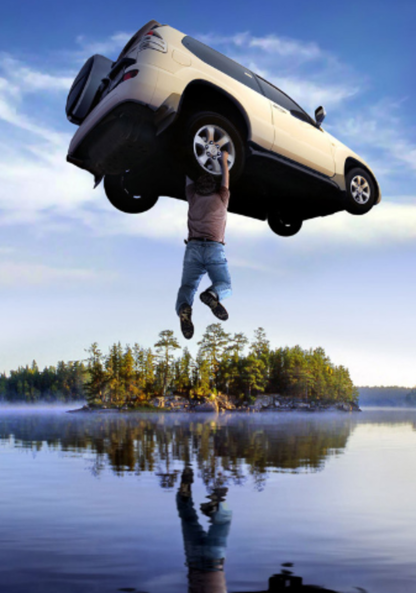 Man levitating car into the air over a lake