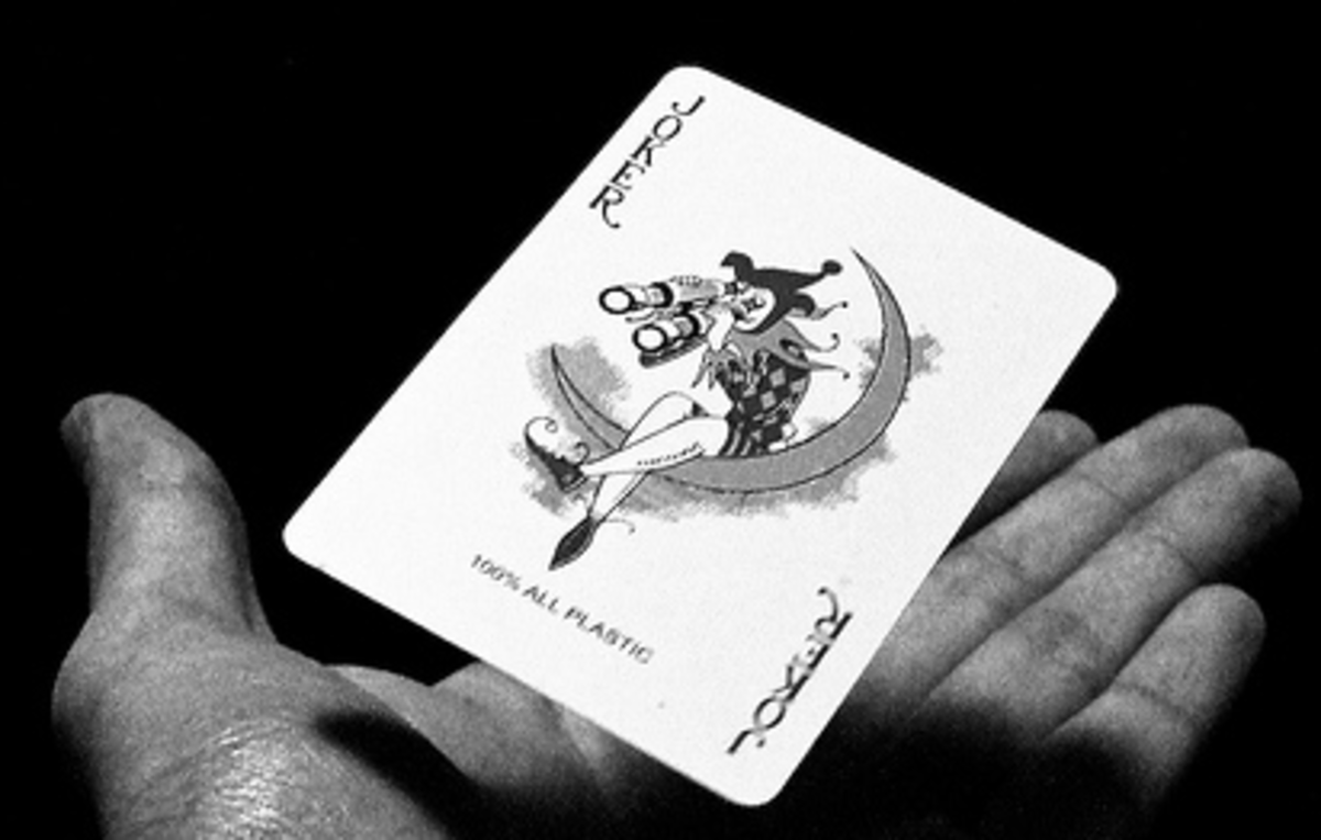 levitating a joker card over the palm of a hand
