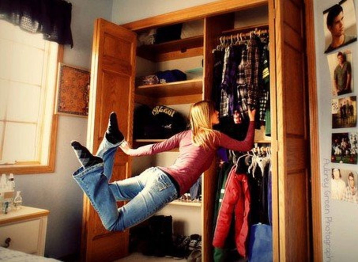 girl levitating in bedroom while looking through clothes-closet