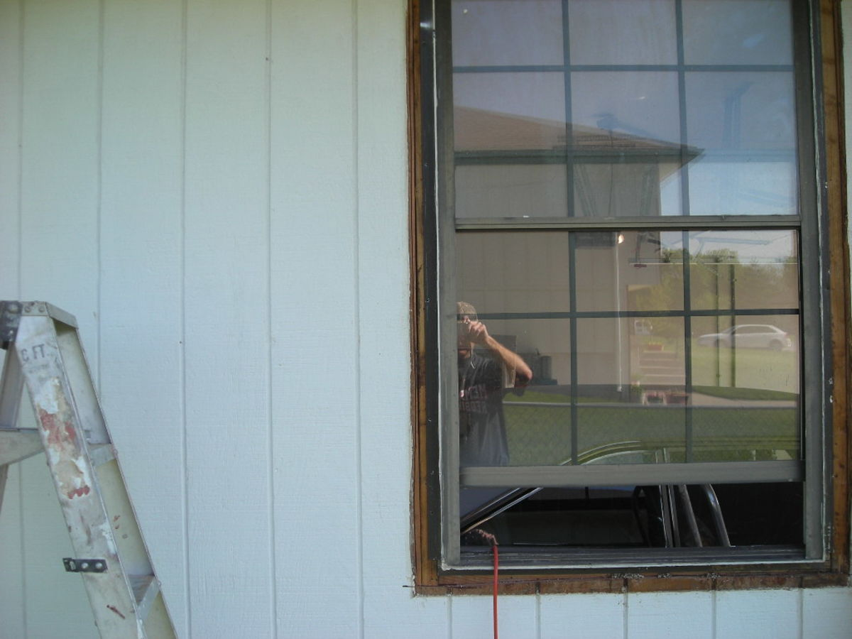 The Old Window With Siding Cut Back