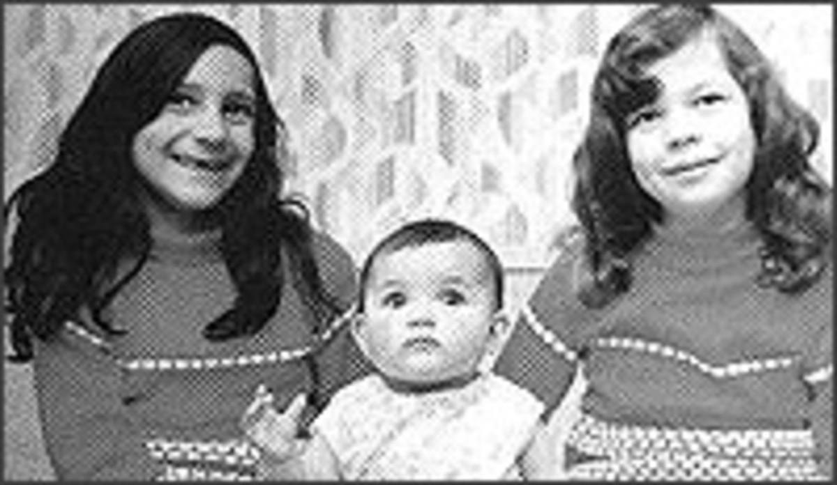 Charmaine (left), baby Heather and Anna Marie