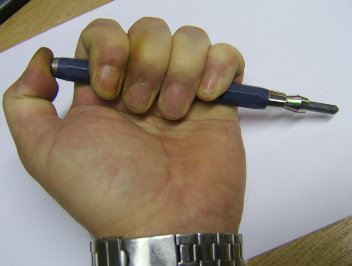 Just press the button as shown in picture and out pops a point it saves a lot of time sharpening pencils and has many more benefits. Almost as good as a graphite stick and saves getting your hands and face dirty from the graphite rubbing onto them.