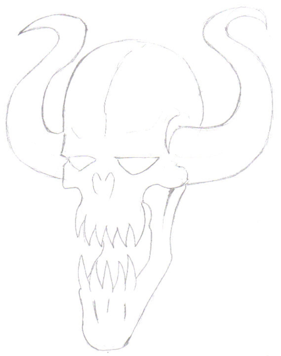 The important features are pencilled in. Eyes, skull nose horns etc.  The demon is looking demon like now.