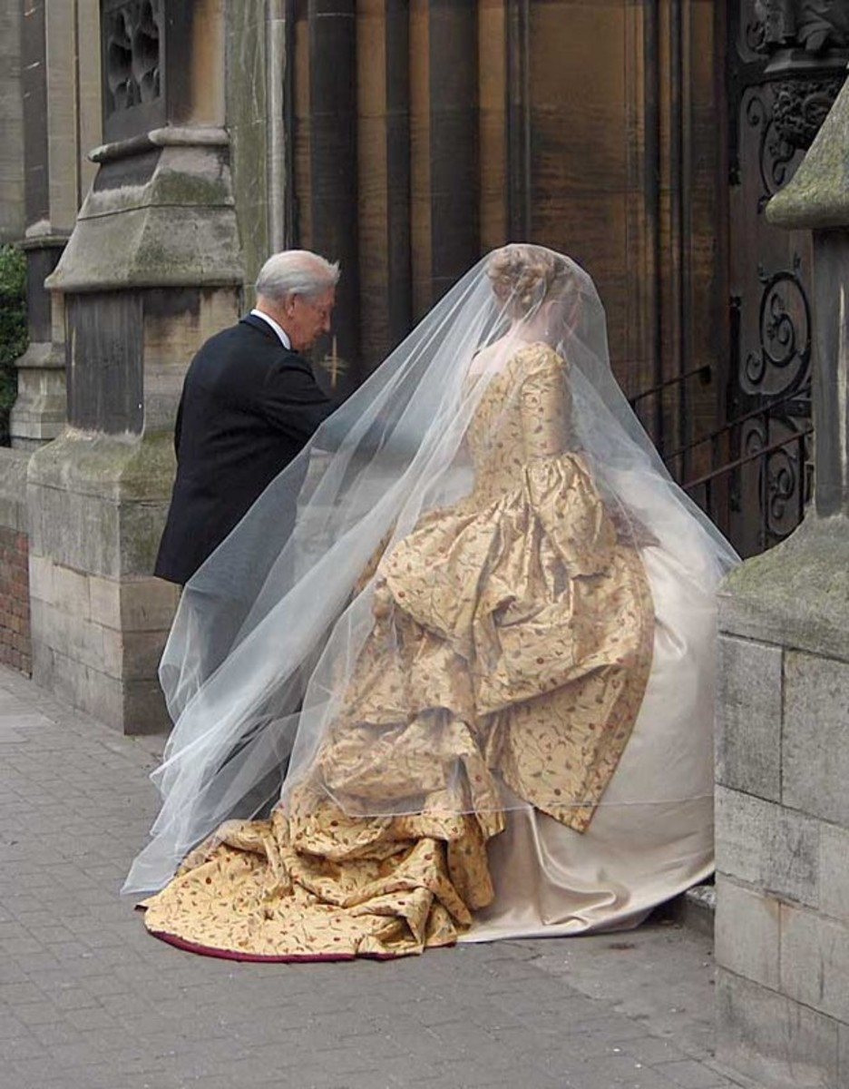 Gold corsetted 18th century style wedding gown, made to order by Harman Hay, 2005