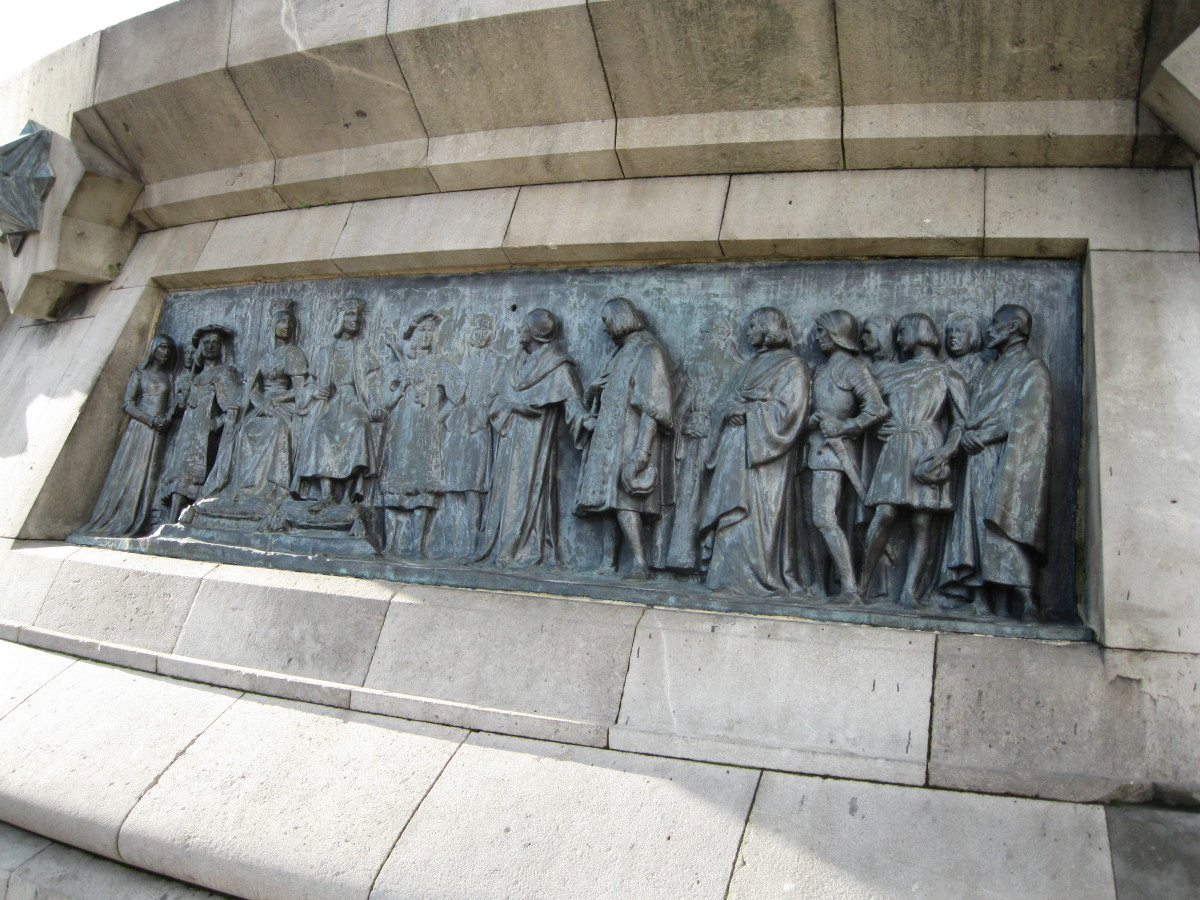 Columbus meeting with King Ferdinand and Queen Isabella in Cordoba, Spain.  Bronze sculpture at base of Columbus Monument, Barcelona, Spain