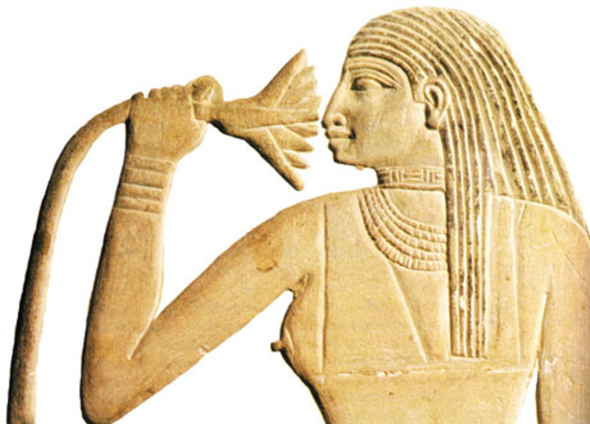 Ancient Egyptian smelling a Lotus.