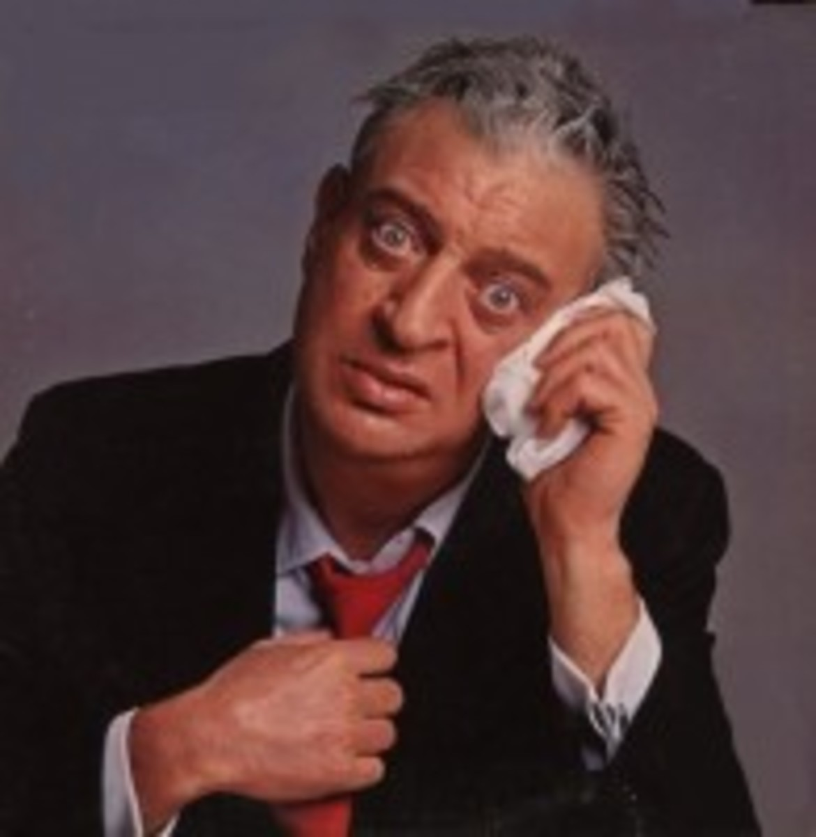 """Comedian Rodney Dangerfield was known for his signature behavior of tugging on his tie and saying """"I don't get no respect."""""""