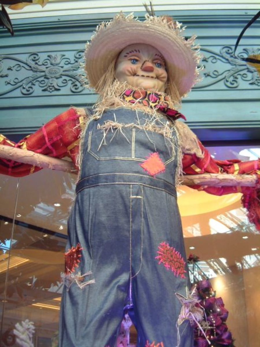 Scarecrows symbolize the fall bounty, being stuffed with straw from the grain harvest, as well as being a protective totem.