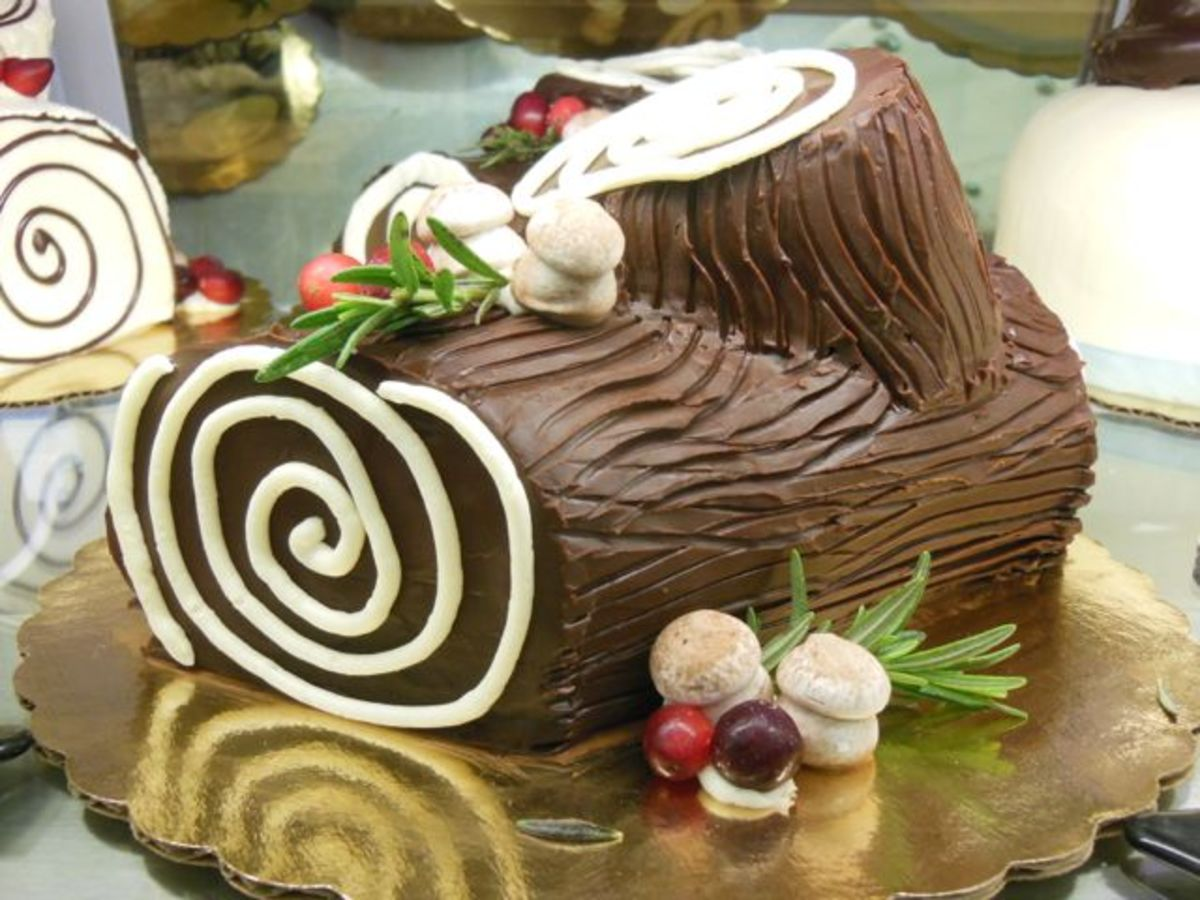 Scoring the icing and adding some meringue mushrooms helps make the cake look more like a real log.