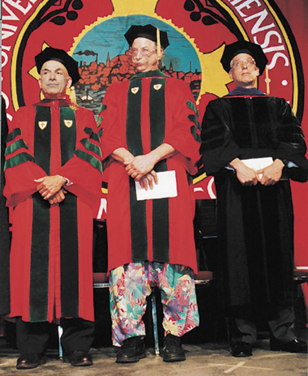 Patch Adams (center)