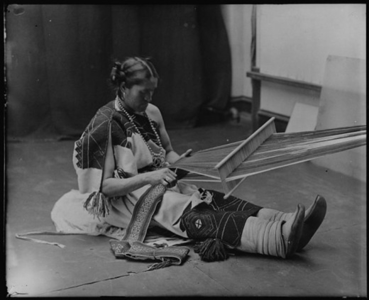 Zuni woman with a large lap loom