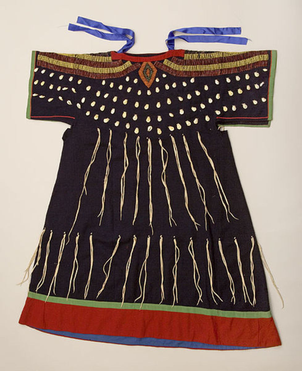 Often found in Idaho, the wing dress came from the tail dress or two hides dress. The T-shaped yoke extends into cape-like sleeves. A printed cotton shirt or skirt was worn under the wing dress.