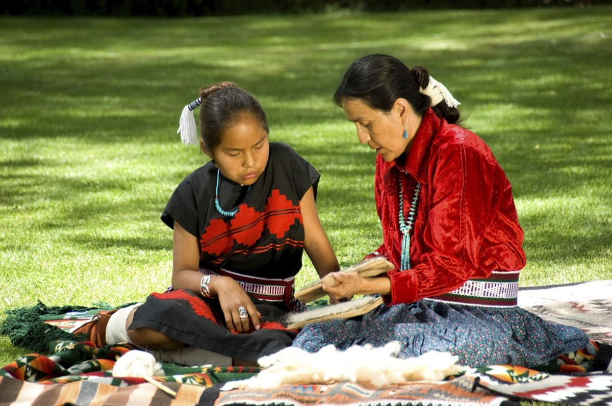 Navajo woman and girl, sharing culture.